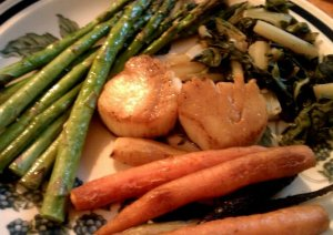 Sea scallops with roasted asparagus, roasted tri-colored carrots and steamed green chard. Fewer than 200 cals on that plate.