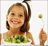 child smiling about brussels sprouts