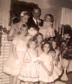 My parents on their wedding day surrounded by a host of nieces and my mother's little sister, my precious Aunt Judy.